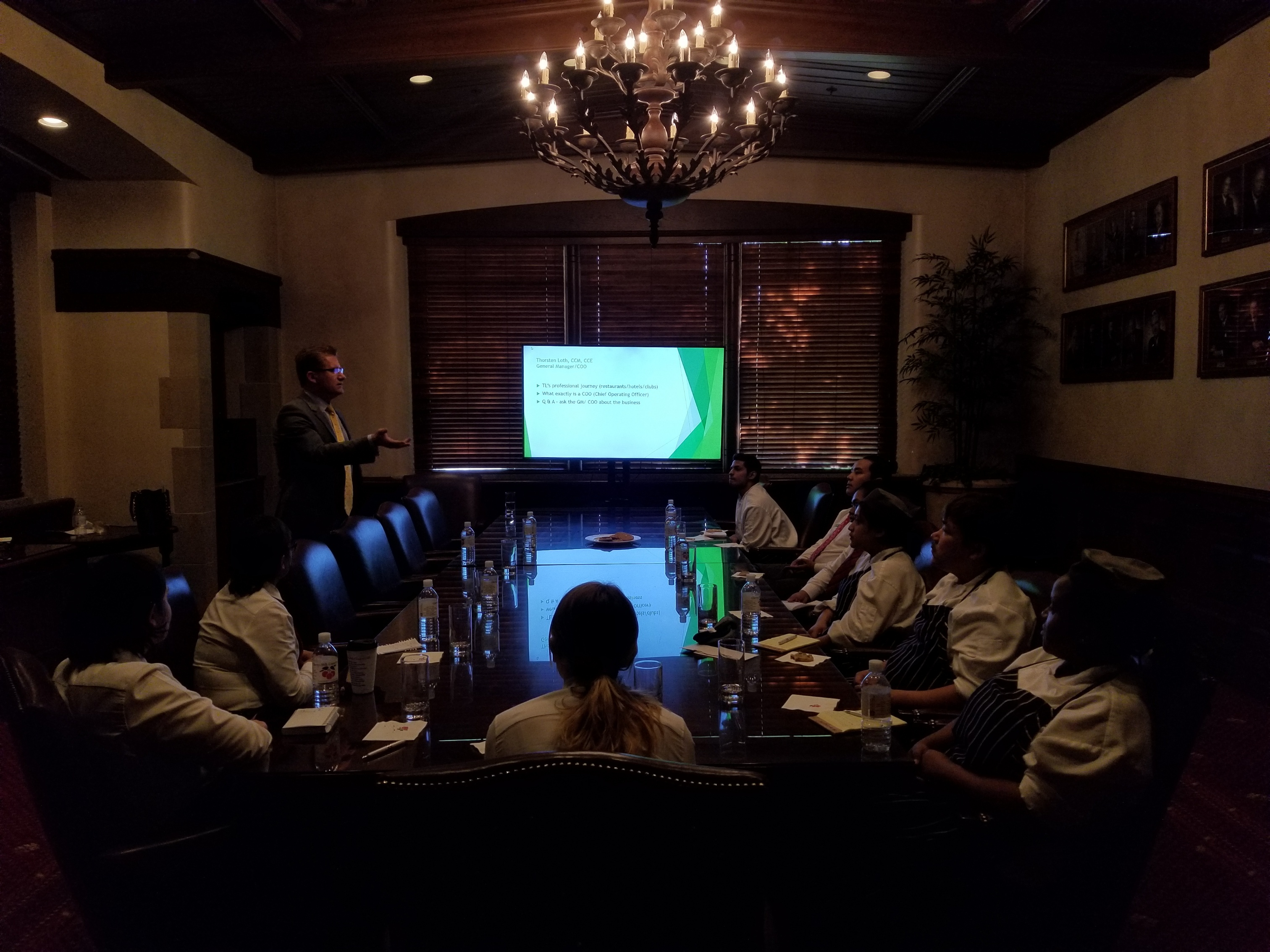 Hospitality professionals attending a lecture.